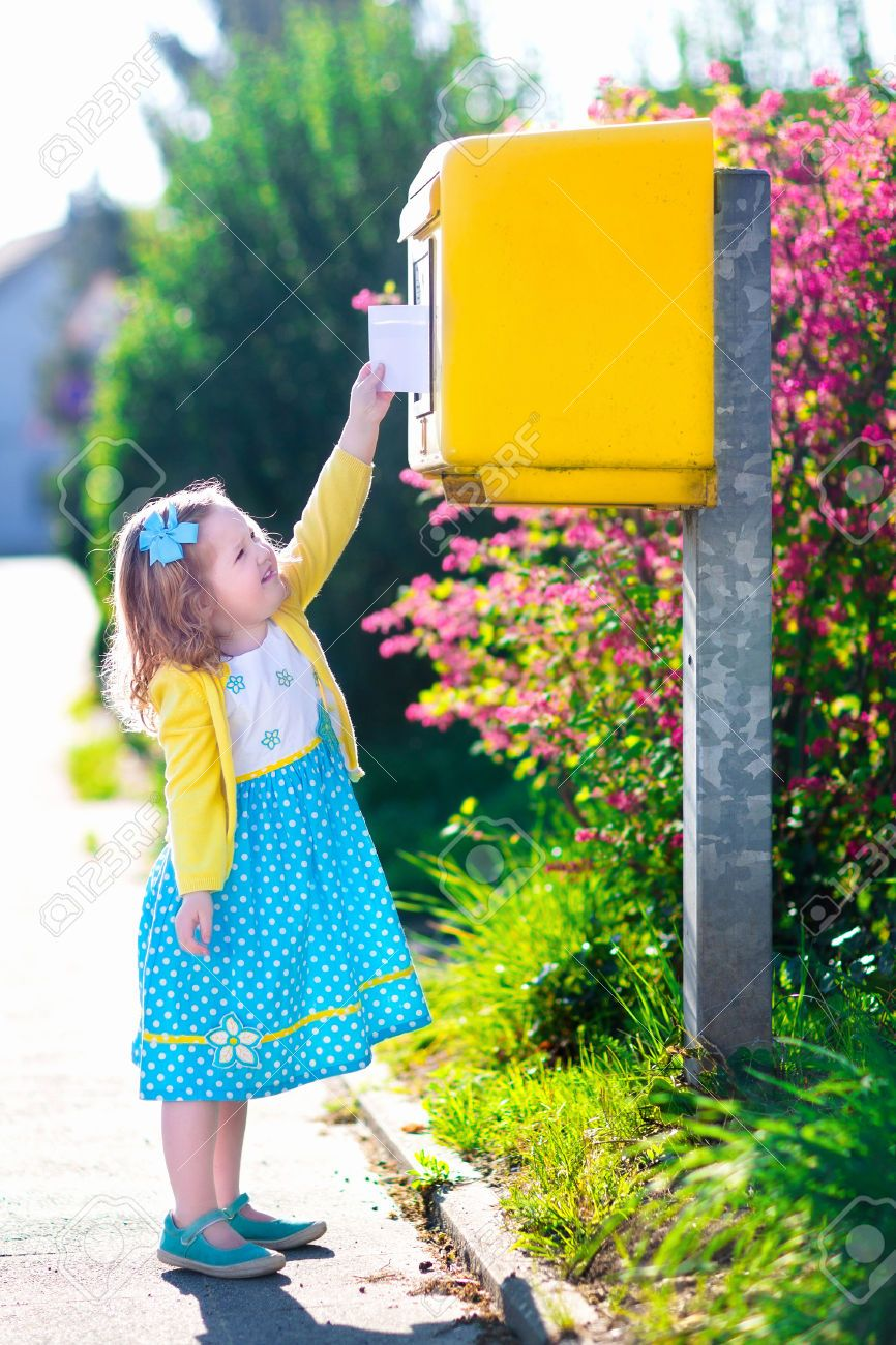 LittleGirlWithAnEnvelopeAtPostOfficeChildSending