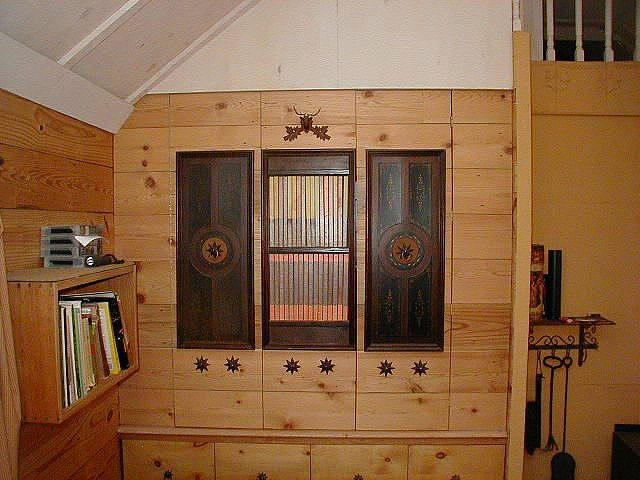 Faux bookcase is door to bed cupboard by Movable House, via Flickr
