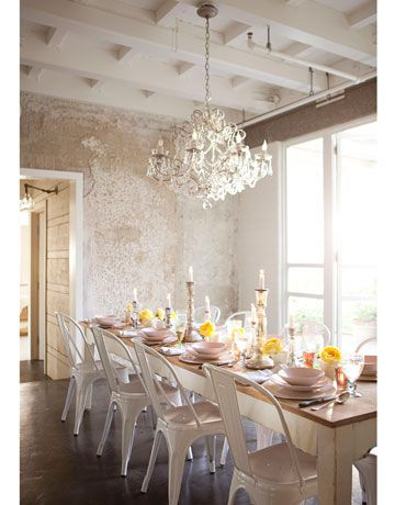 Light soaked white dining room with yellow floral accents.