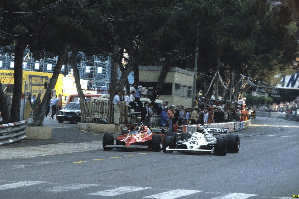 Monaco 1981: Gilles Villeneuve passes world champion Alan Jones's faltering Williams on the way to a famous win, the first for a turbocharged Ferrari.