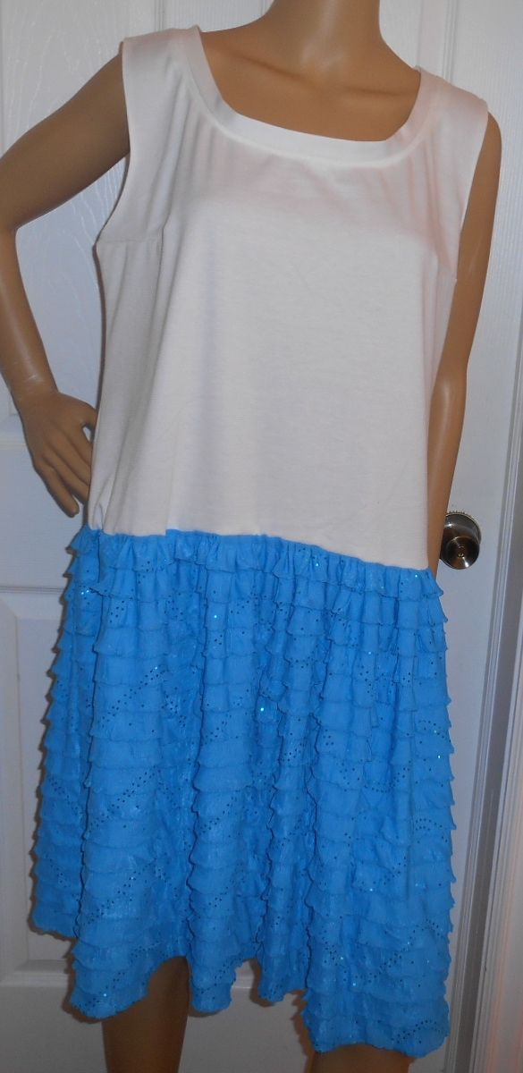 Chemise dress with Ivory ponte knit on top and pool blue poly lycra ruffle knit bottom has sequin sparkle. Fresh and young