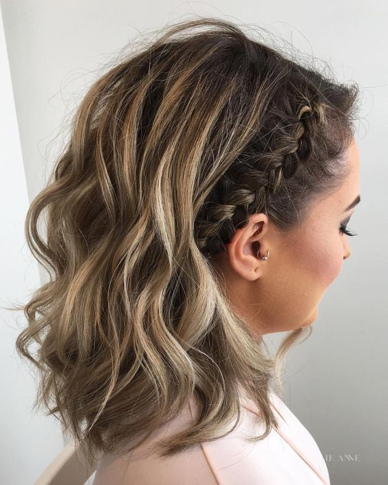 wavy medium length hair with a side braid is a trendy idea with a slight boho feel #sidebraidhairstyles