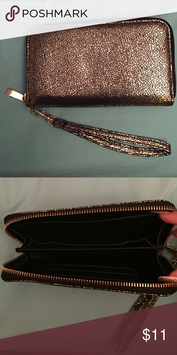 Black and Gold wallet This is a cute black and gold wallet with a leather interior. There is a removable wrist strap so you can use it as a wristlet as well. Bags Clutches & Wristlets