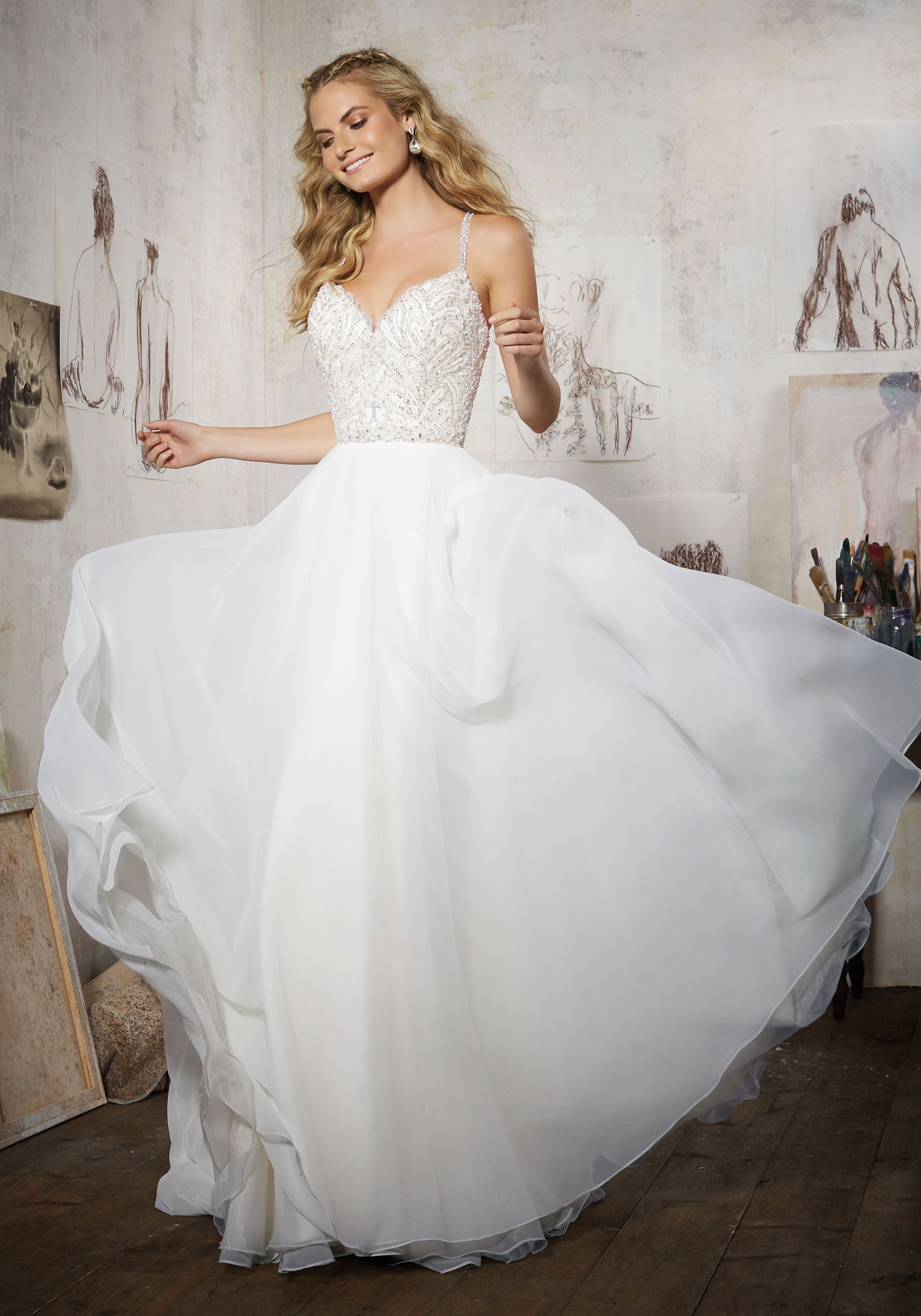 Where can i rent a wedding dress  DiamantŽe Beaded Bodice Perfectly Complements this Silky Chiffon