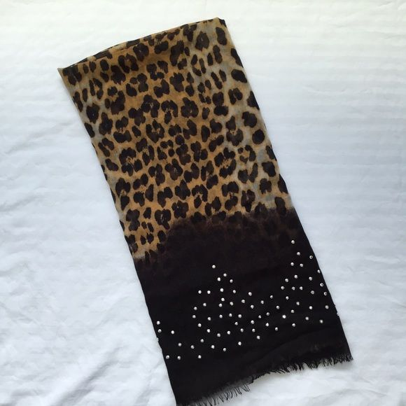 Black and cheetah scarf NWOT black and cheetah scarf with embellishments. It's a dress scarf, so it's very thin material. Accessories Scarves & Wraps