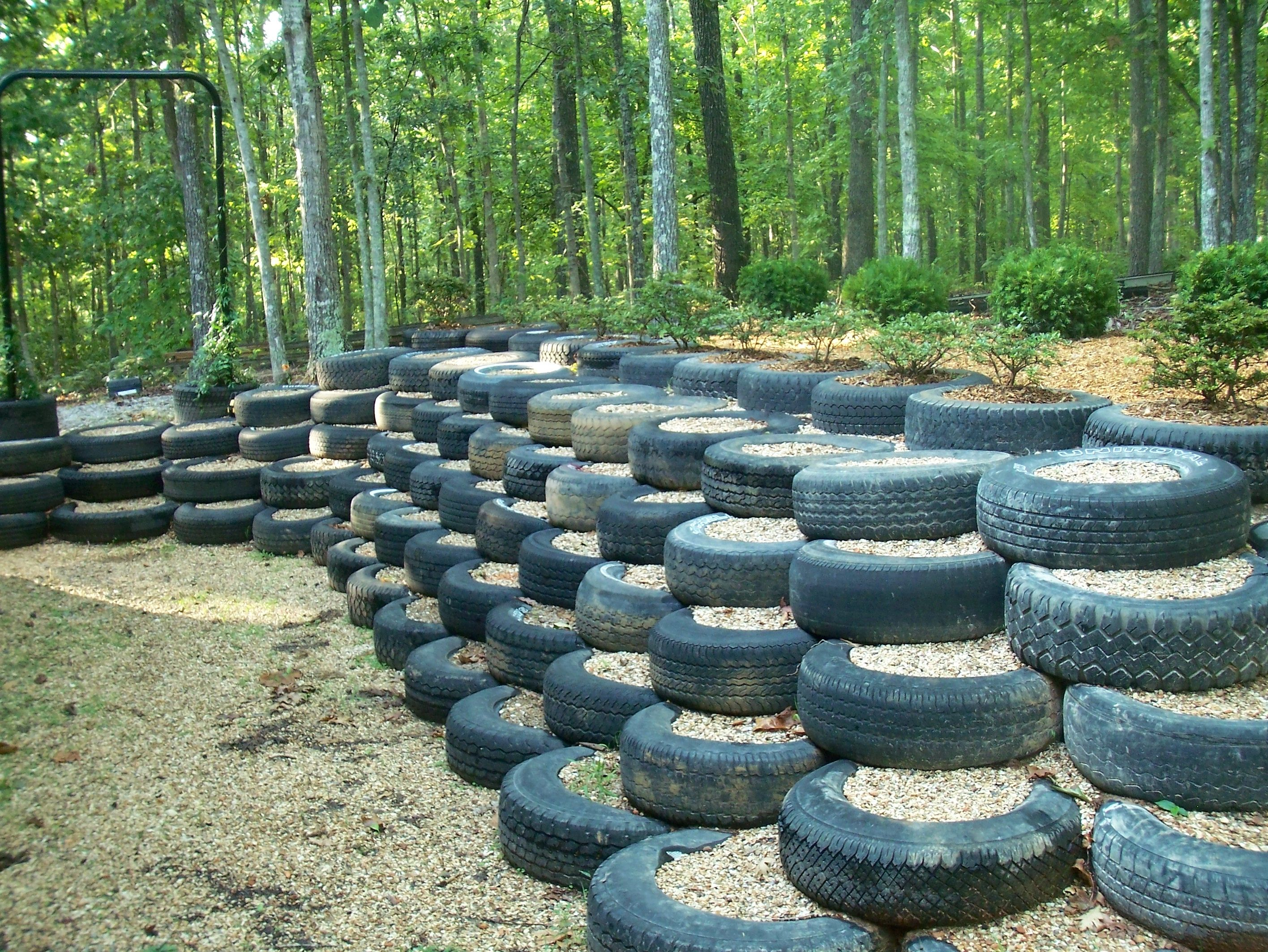 I did this retaining wall made from used tires for How to use old tires in a garden