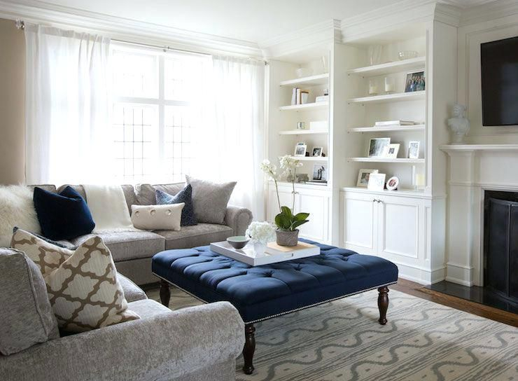 Navy And Grey Living Room Ideas Elegant Living Room Features Traditional Fireplace Under Flanked By Built Blue Living Room Living Room Grey Elegant Living Room