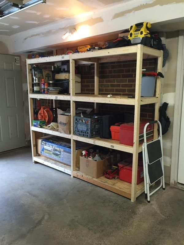 i built these shelves to create some heavy duty storage in my garage theyre super easy to build from 2x3 boards and plywood - Heavy Duty Storage Shelves