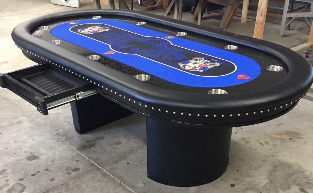 custom poker table with family crests on custom felt