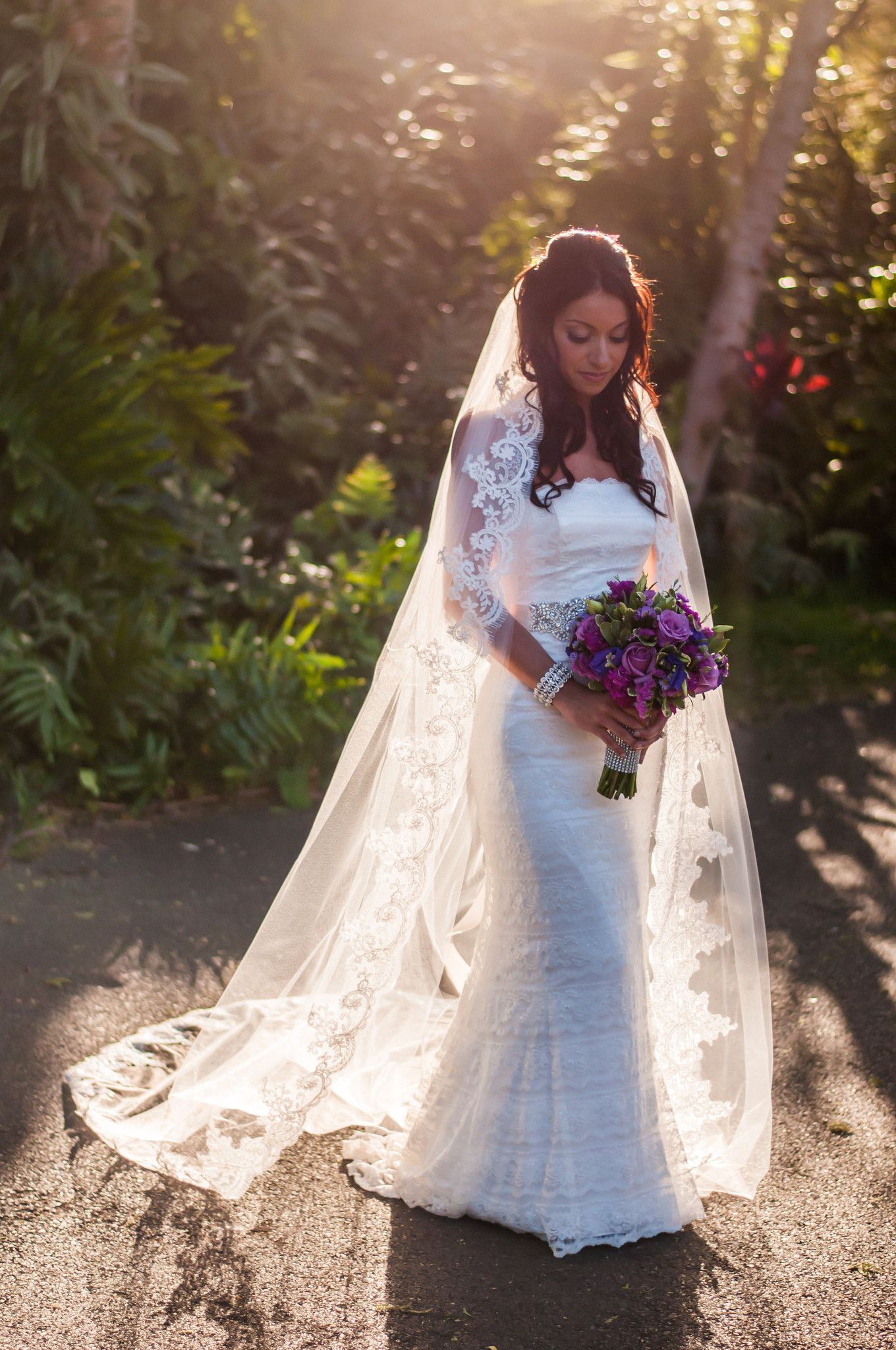 A bride poses before her wedding in makena maui hawaii wedding