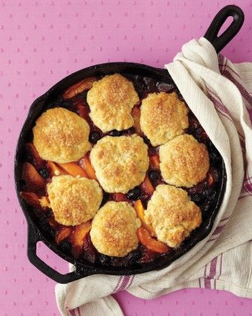 This+irresistible+home-style+dessert+is+full+of+lush+blueberries+and+apricots,+complemented+by+tender+biscuits.+Serve+it+up+in+a+cast-iron+skillet+for+extra+homespun+flair.