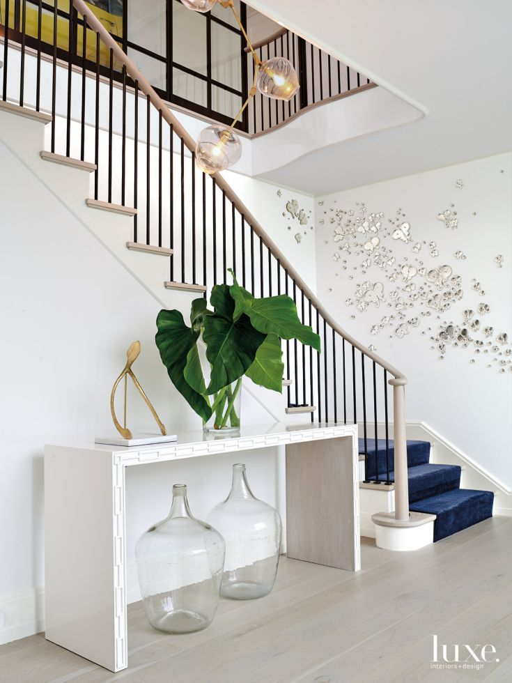 Modern White Staircase with Mirrored Butterfly Wall Décor ...