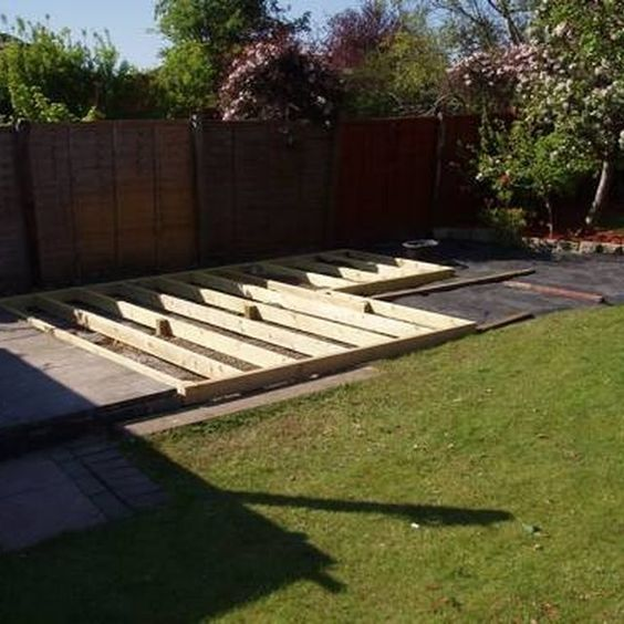 How To Make A Ground Level Wooden Deck Hunker Building A Floating Deck How To Level Ground Decks Backyard