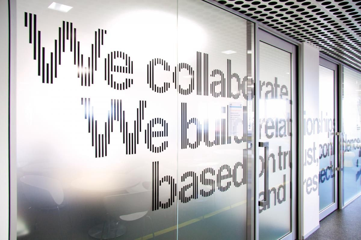 Typographic glass panel graphics at sap headquarters australia office wall art office wall design