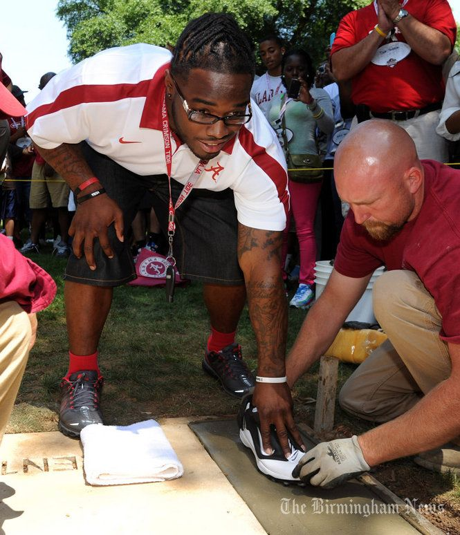 Trent Richardson, Mark Barron, and Dont'a Hightower added their hand and footprints to Walk of Fame at Denny Chimes before A-Day game.