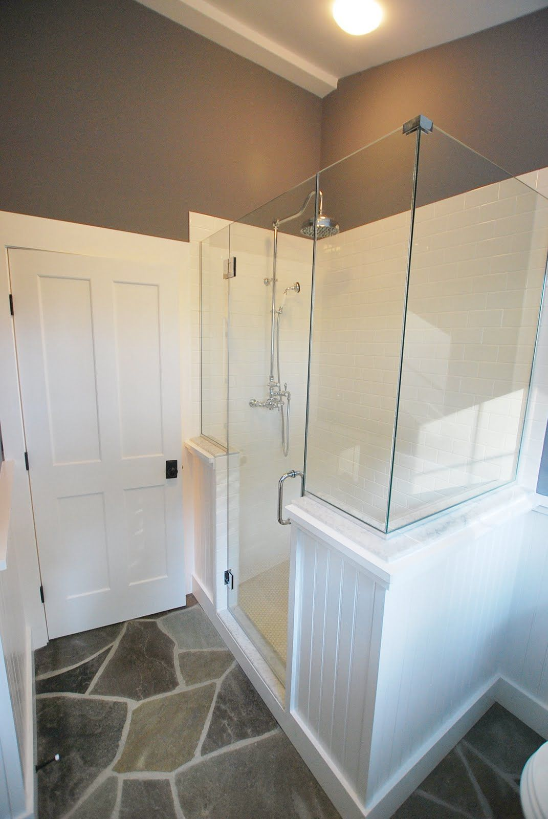 wainscoting and frameless glass shower enclosure. not fond of the ...