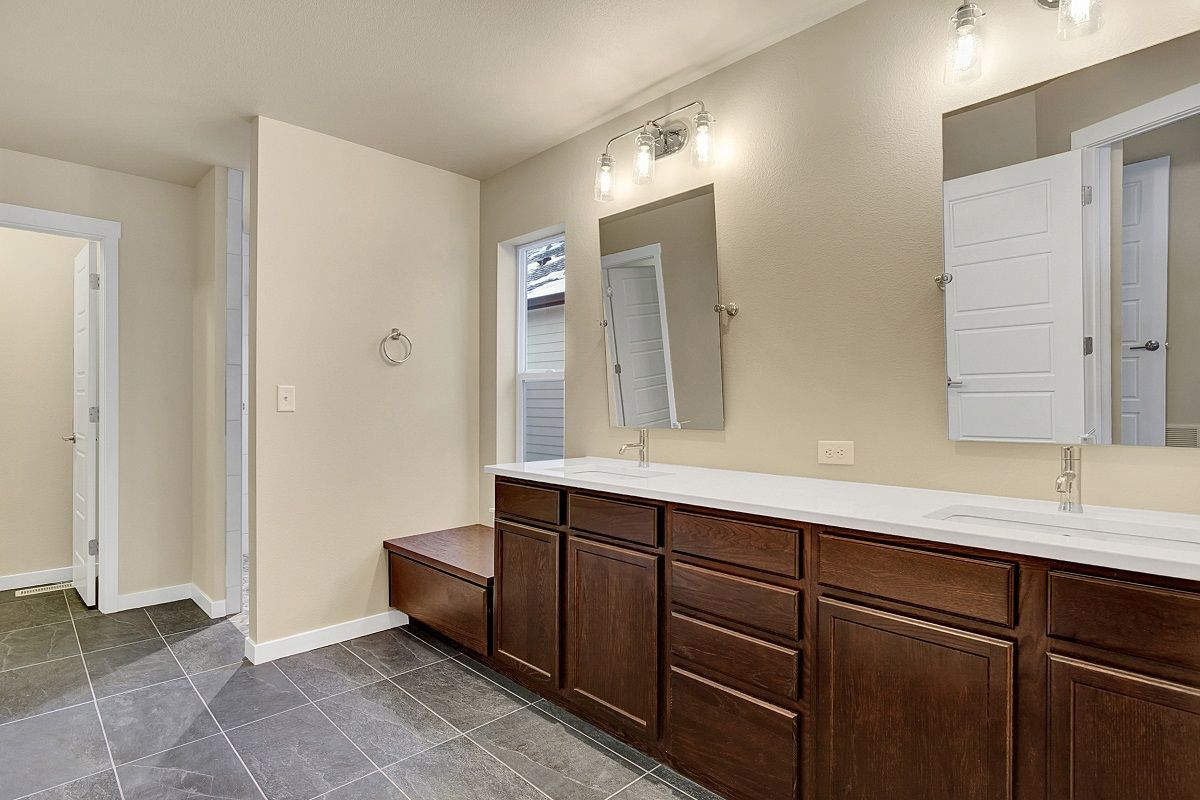 Master bathroom with large vanity including stone slab countertop