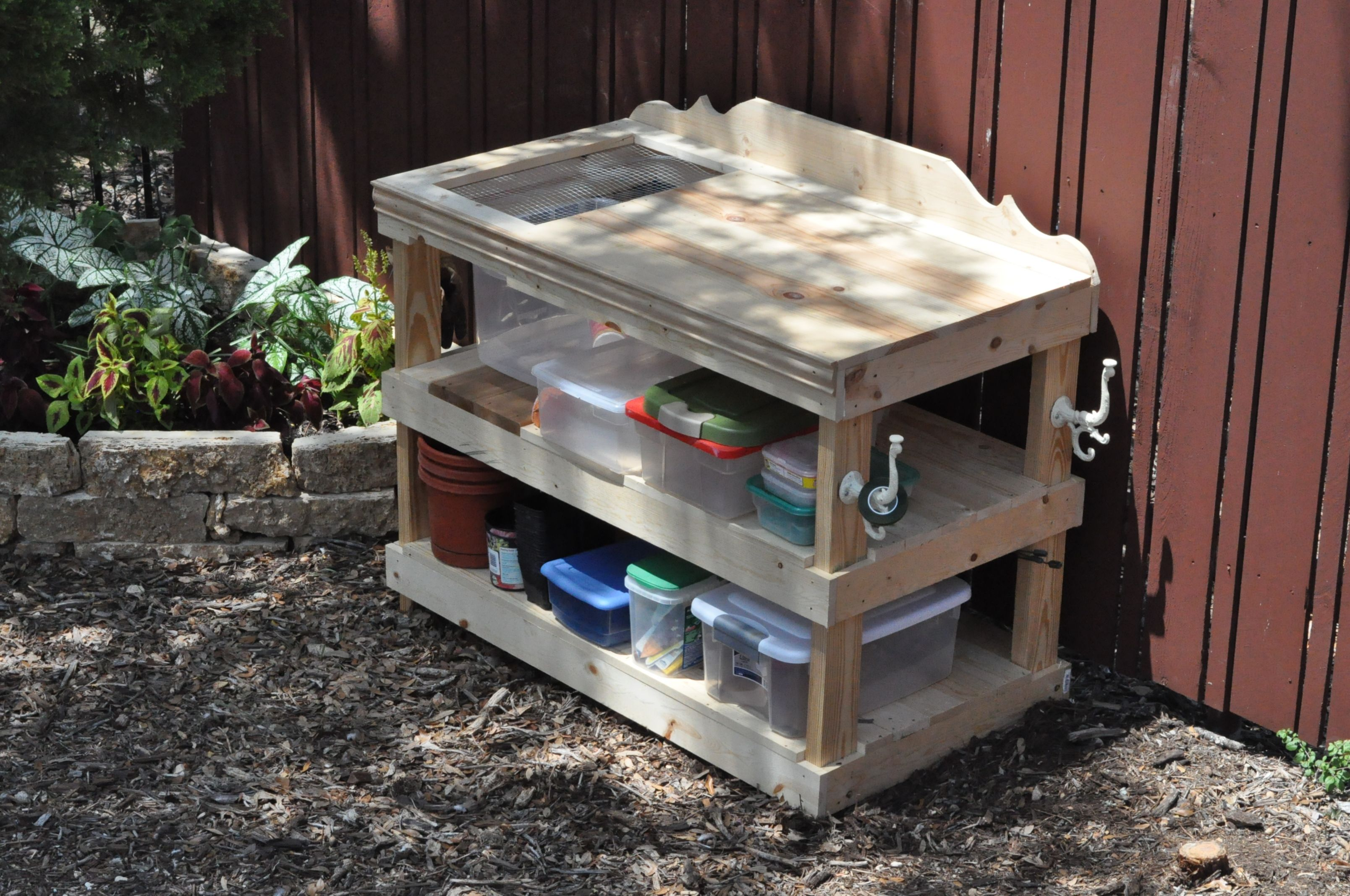 My planting Table that the soon to be hubby made for me!  After a walk through a bib box store....I was admiring a garden table and when I got home the next evening. Wha Laa.  Love it!