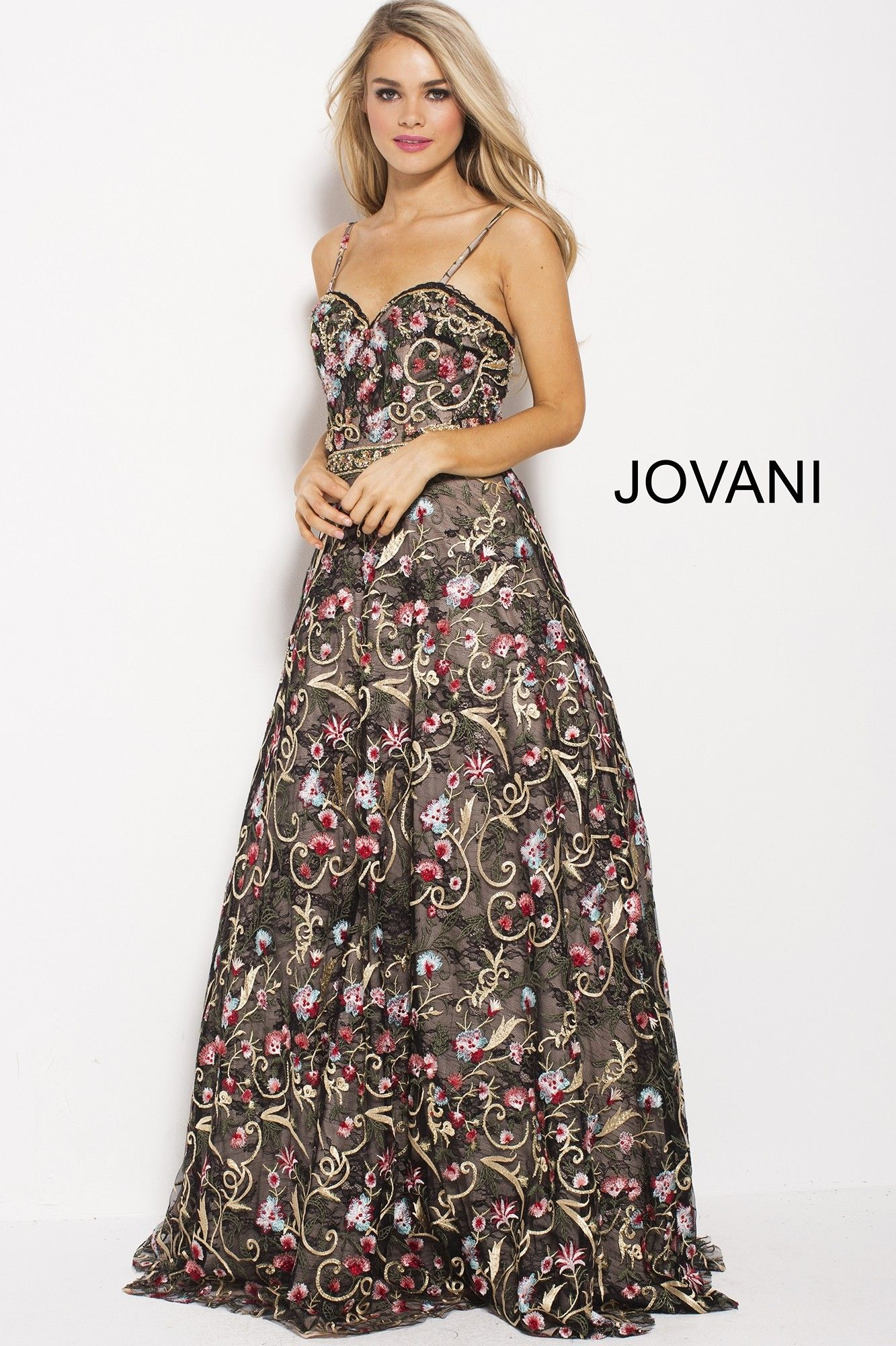 9efeb1ce6cad This whimsical lace gown is covered in lively floral embroidery. The bodice  has a sweetheart neckline, spaghetti straps, square back, ...