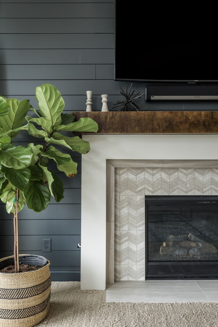 Photo of Black shiplap around fireplace with herringbone tile | MAWR Design