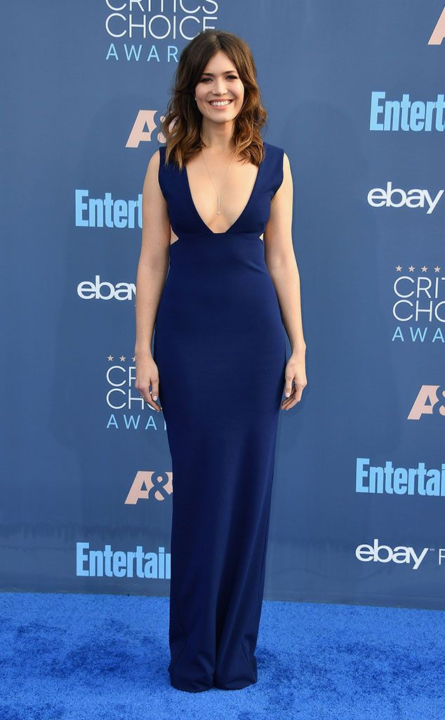 Oh la la! The This Is Us star stunned in aplunging navy gown with her loose locks and nude lips.