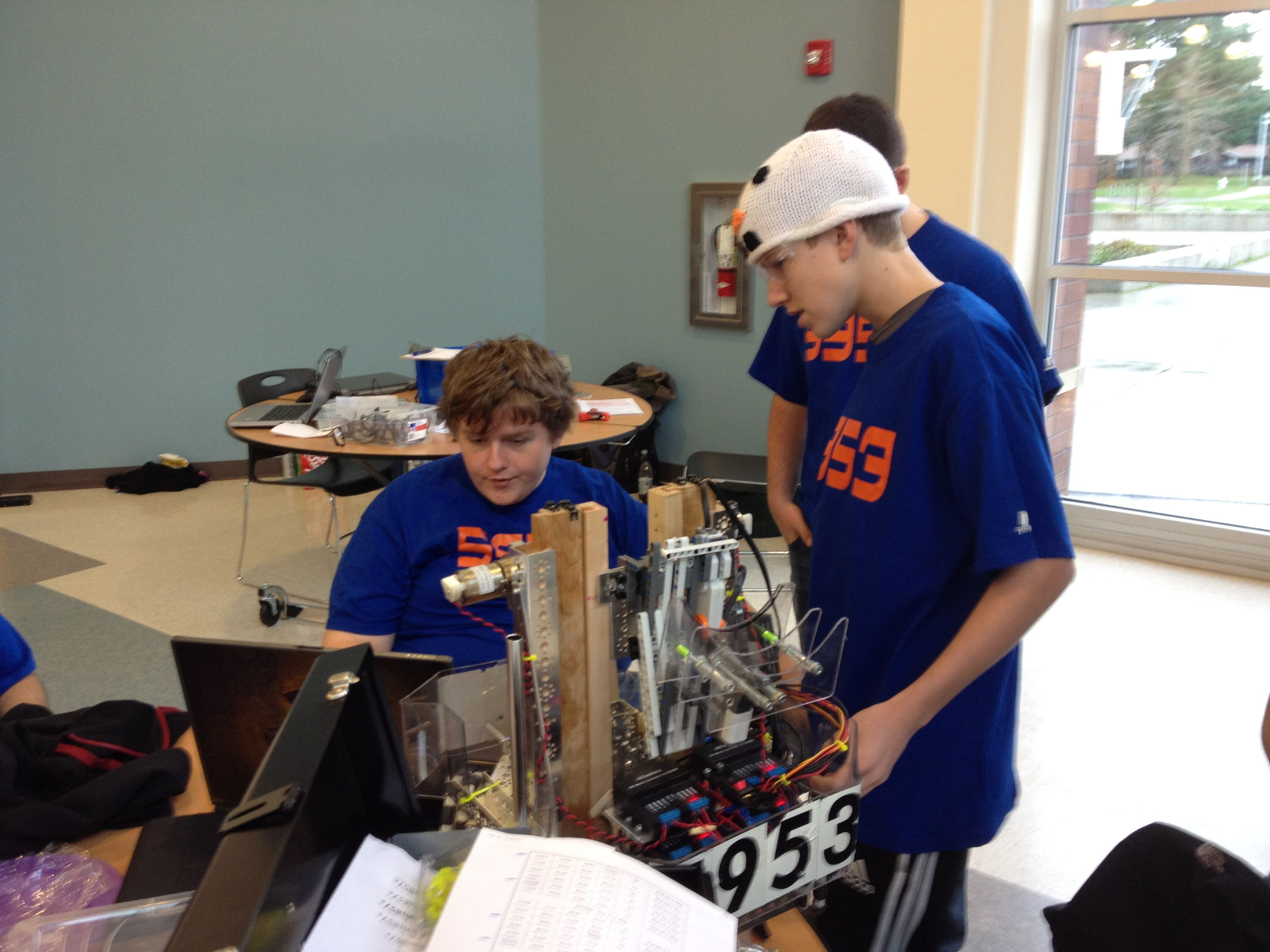Students work on their robot at the Tahoma League
