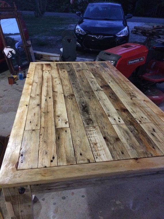 This is a custom, reclaimed, pallet wood dining room table. The frame/structure of the table is made from new whitewood for structural
