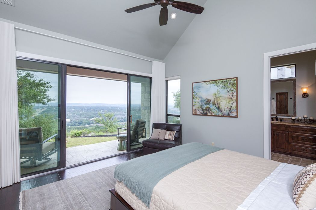 This master bedroom is all about the view sliding glass - Bedroom with sliding glass doors ...
