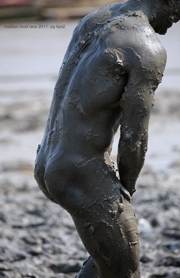 Naked guys in mud