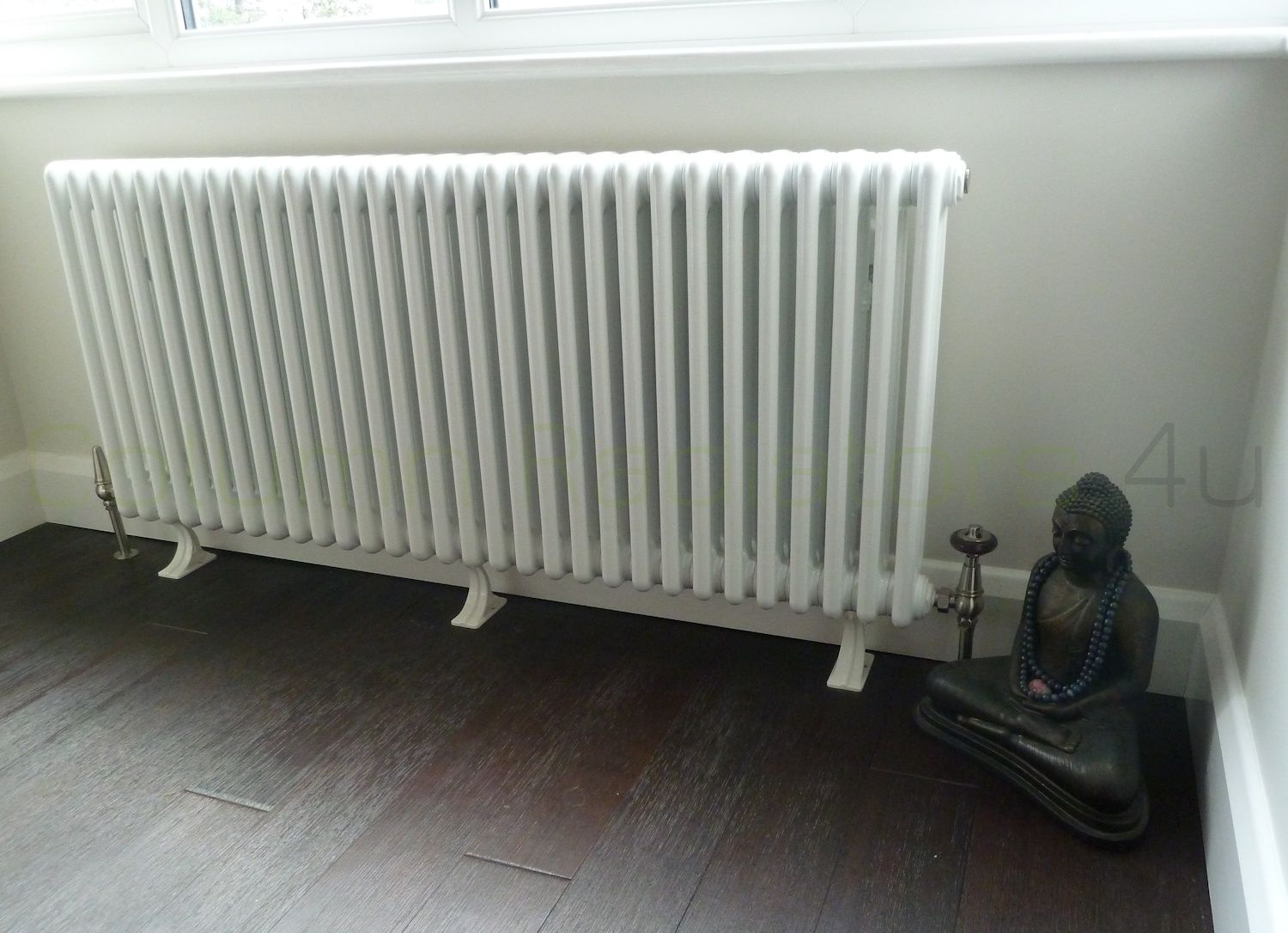 Large white column radiator on cast iron feet dark solid wood floor with a cool : sectional radiators - Sectionals, Sofas & Couches