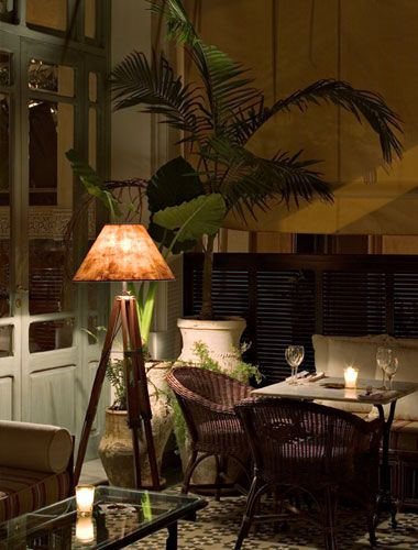 British colonial style under the warm glow of the lamp love this look reminds me of - Salon style colonial ...