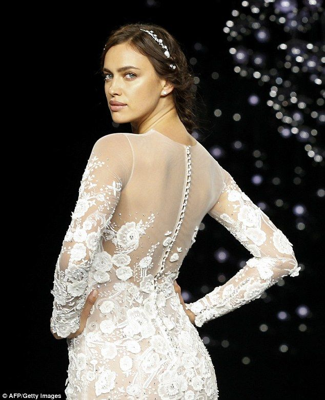 Irina Shayk Looks Sensational In A Form Fitting Lace Wedding Dress
