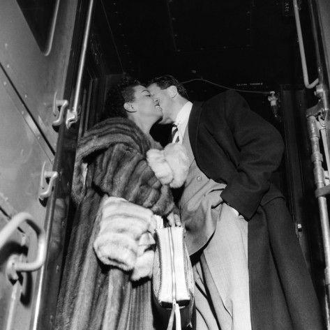 Hazel Scott kisses hubby, Adam Clayton Powell.