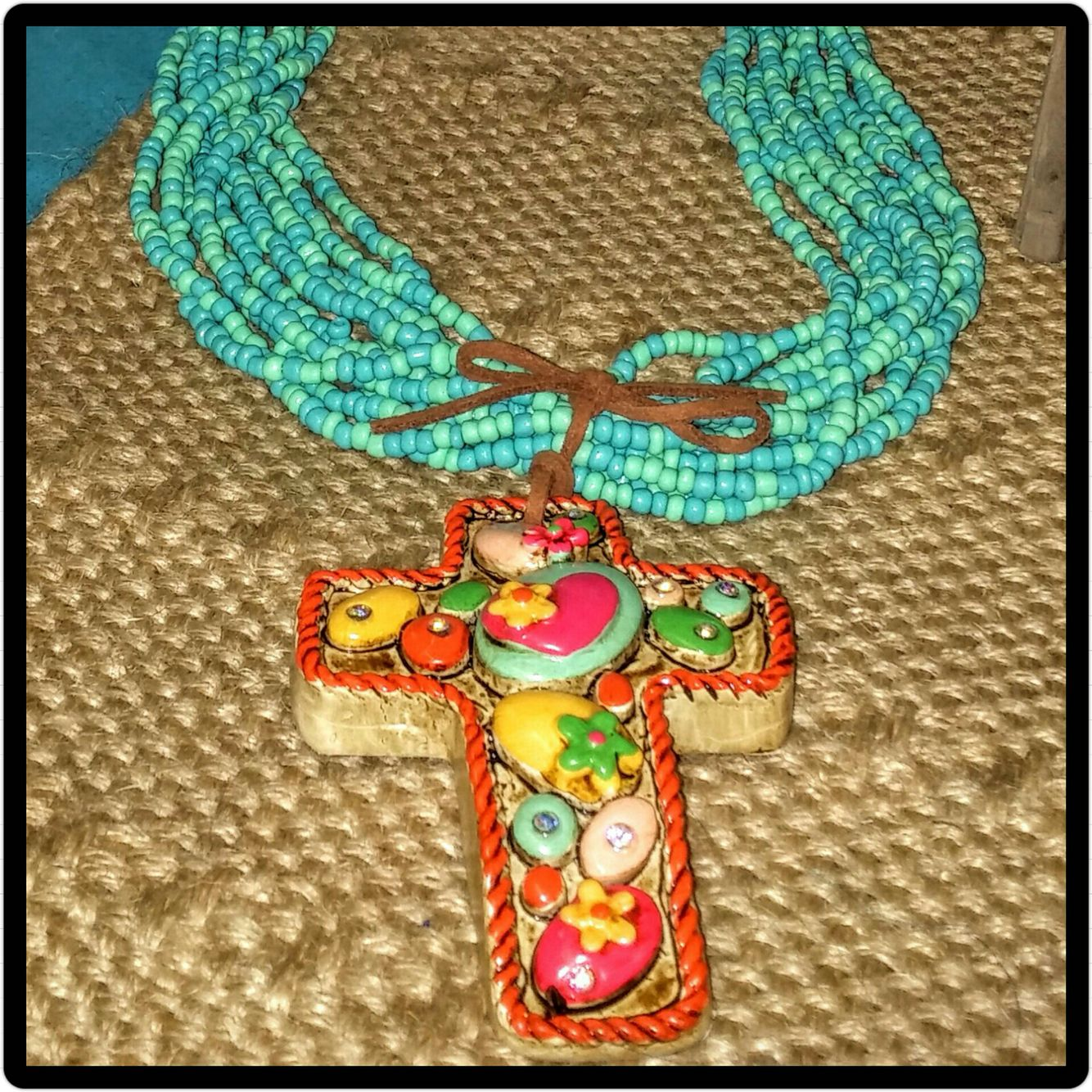 Colorful beaded Cross necklace.