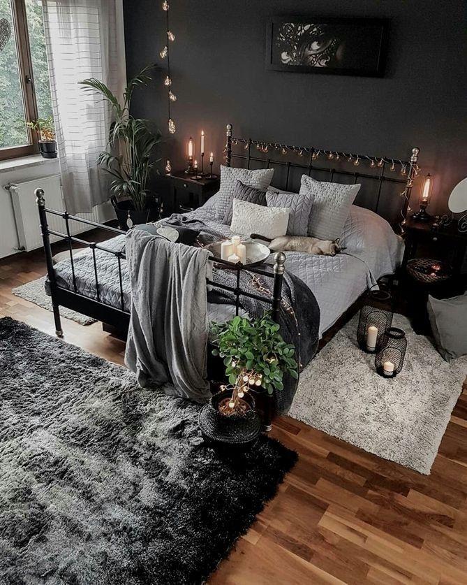 Innenarchitektur des dunklen, schwarzen und gemütlichen Schlafzimmers.-   Innen...