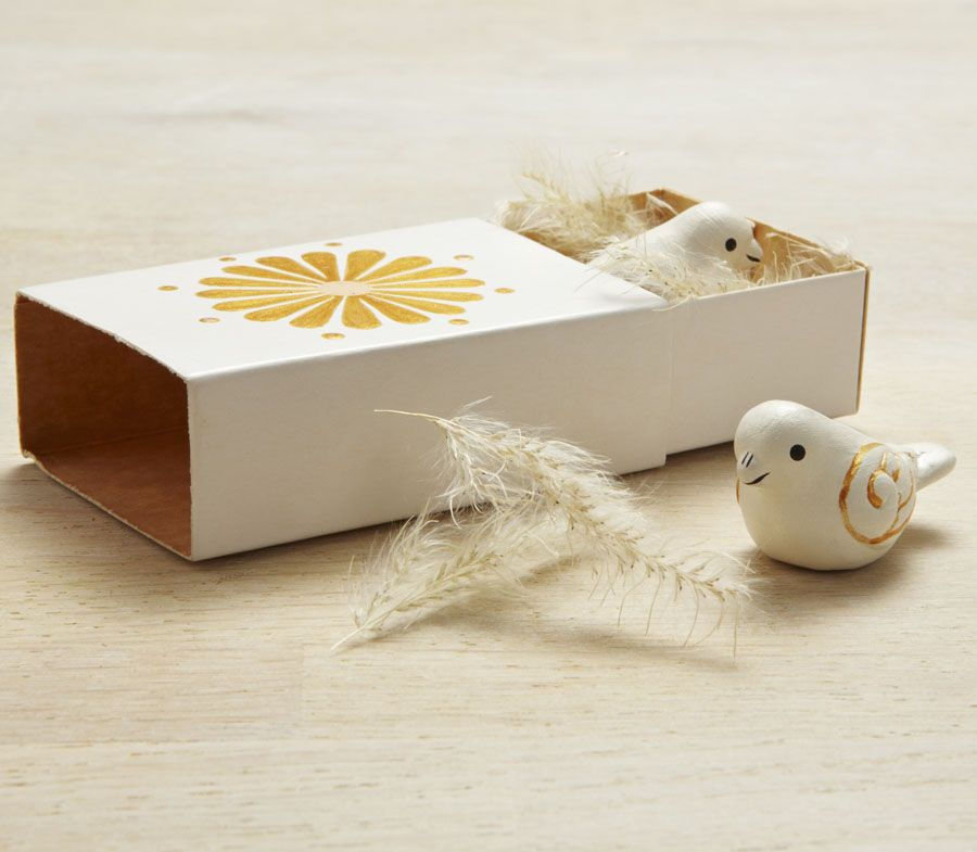 Spread a seasonal message of peace with these two white beautiful terracotta doves nesting amongst dried natural grasses in a small decorative matchbox.