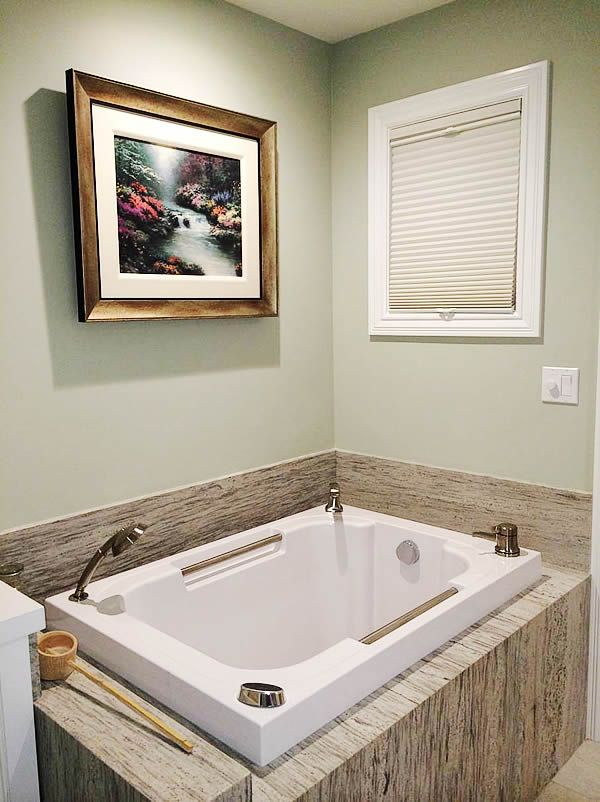The Imersa deep soaking tub, pictured inset in a granite surround ...