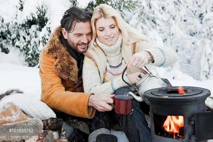 Yooniq images - Austria, Salzburg County, Couple sitting near camping stove and drinking tea