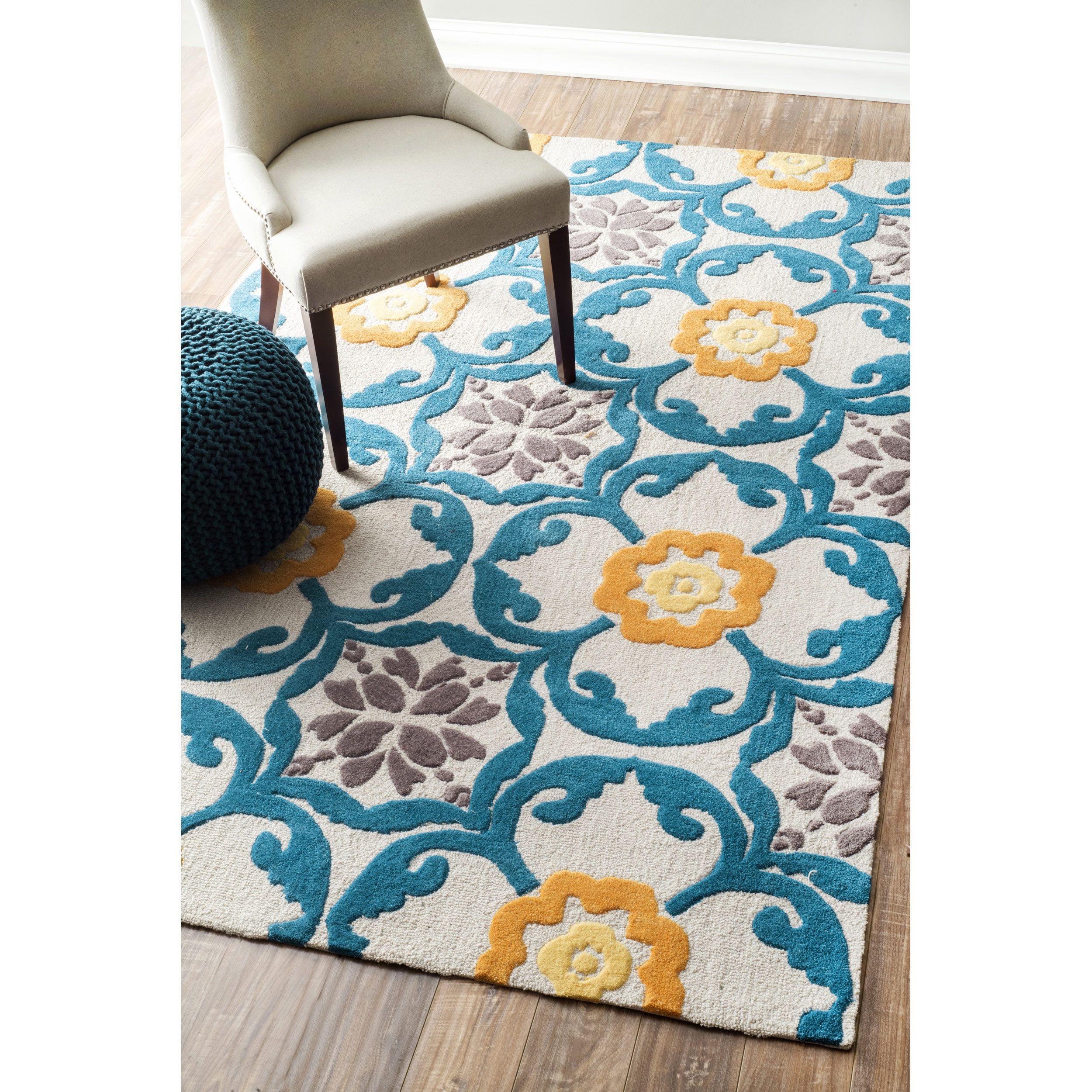 Quality meets value in this beautiful modern area rug. Handmade with ...