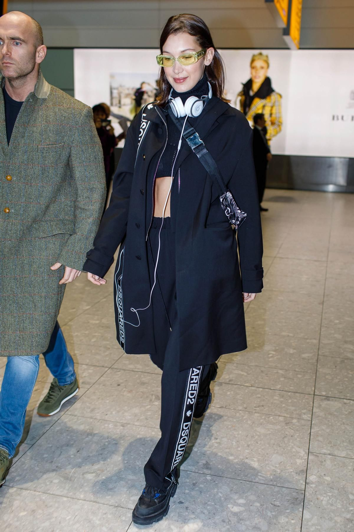 bd7f4bc1c452 Bella Hadid wearing Beats Ep On-Ear Headphones in White, Prada Printed Calf  Leather Belt Bag, Dsquared2 Pre-Fall 2018 Oversized Tape Trench and Both  Gao ...
