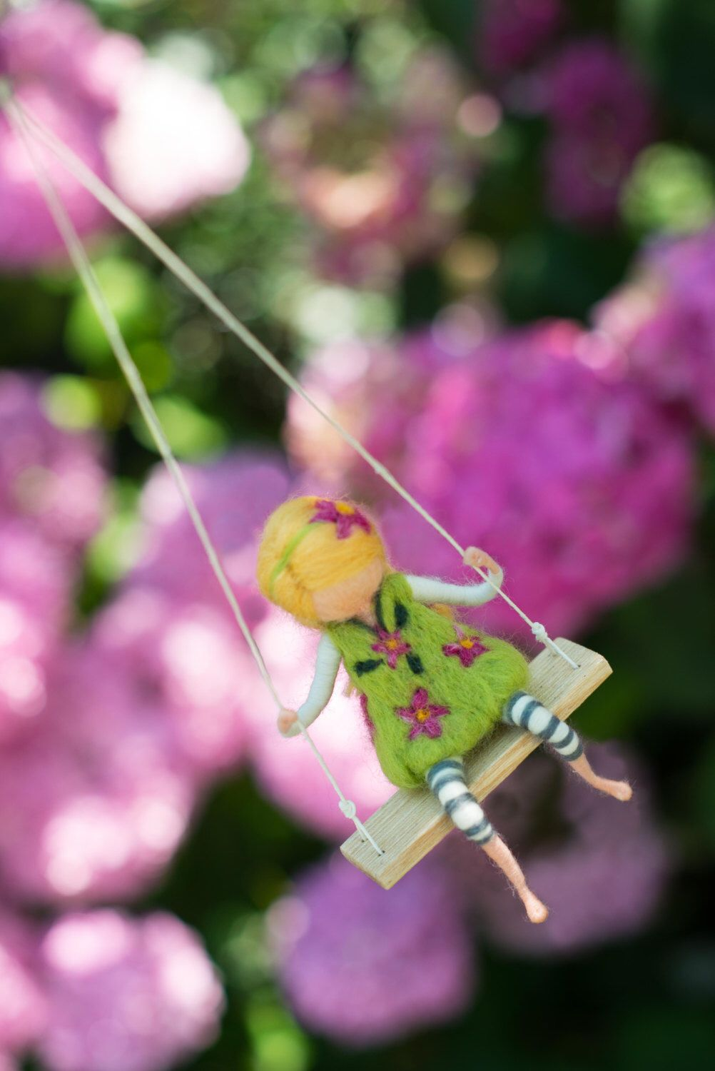 Girl in a green dress with violet flowers on a swing needle felted girl in a green dress with violet flowers on a swing needle felted doll cute and beautiful decoration or gift for all occasions izmirmasajfo Image collections