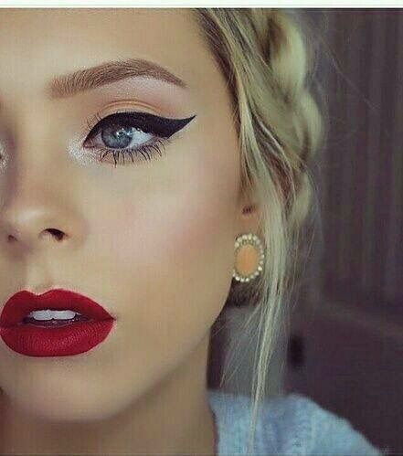Classic Makeup Look Winged Eyeliner A Matte Red Lip With