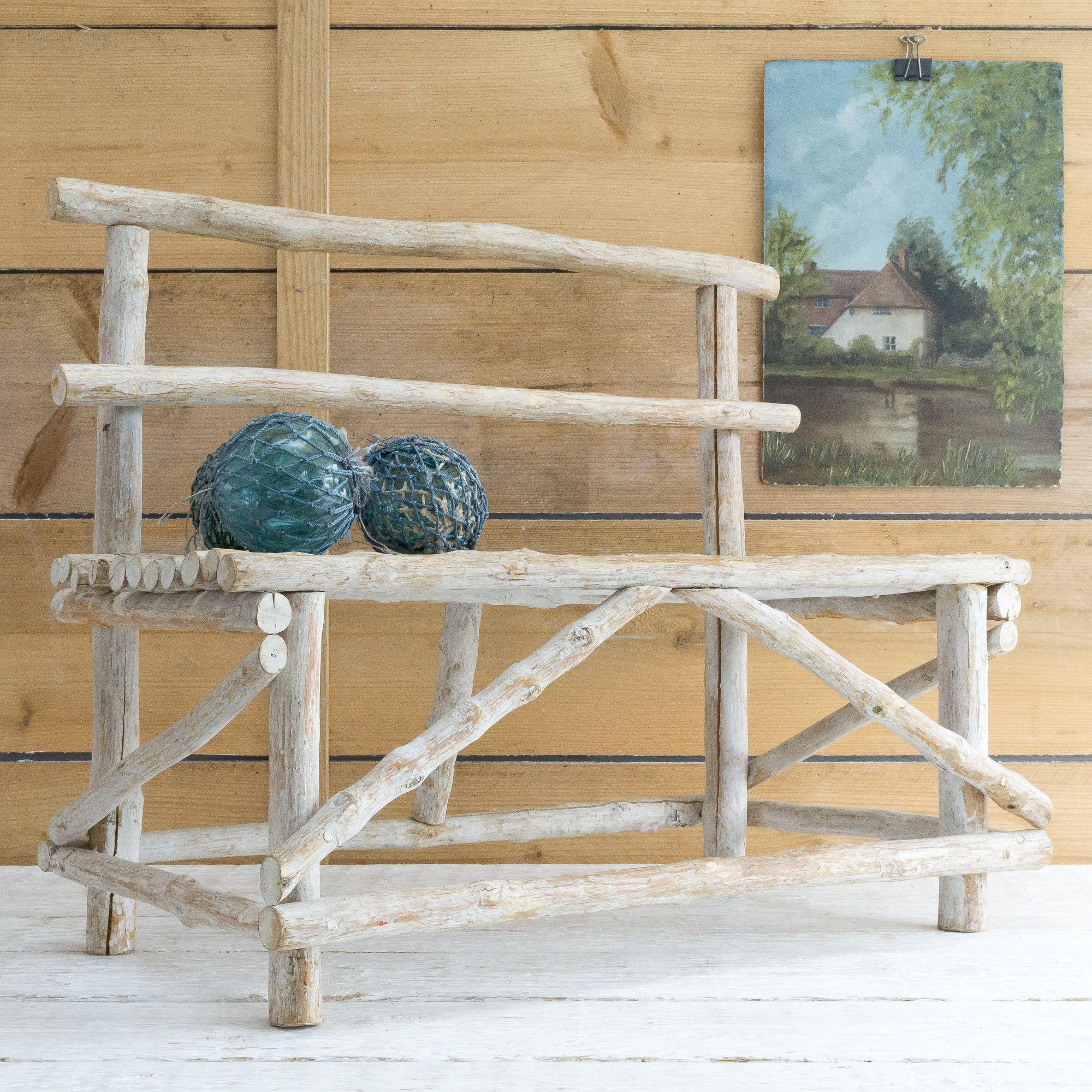 We love this cute little bench made simply of white washed wooden