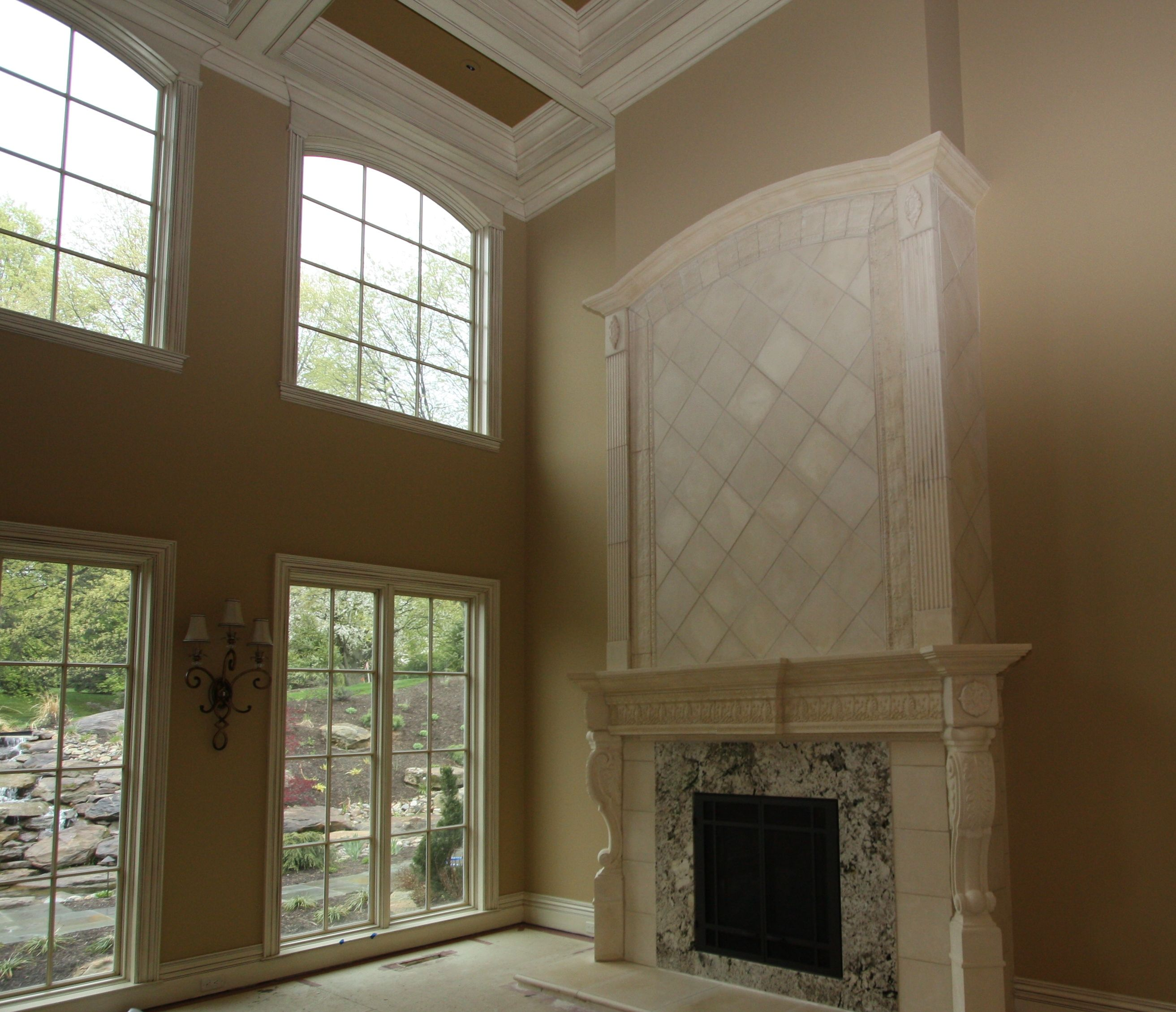 Custom Cast Stone Fireplace With Granite Surround