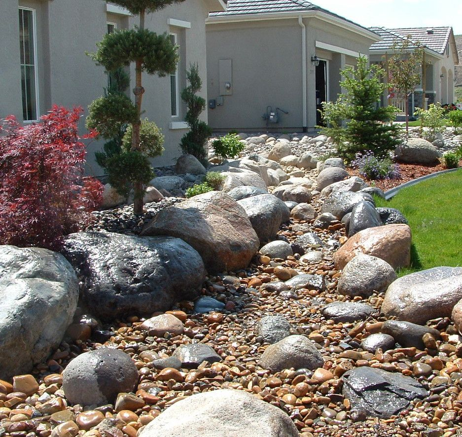 Dry river bed landscaping ideas landscape installation for Installing river rock landscaping