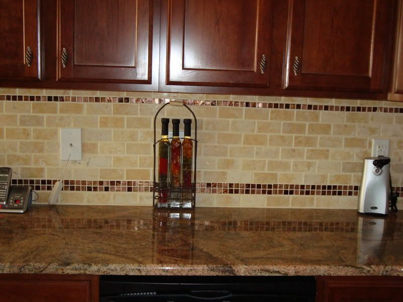 subway tiles with mosaic accentsbacksplash with tumbled