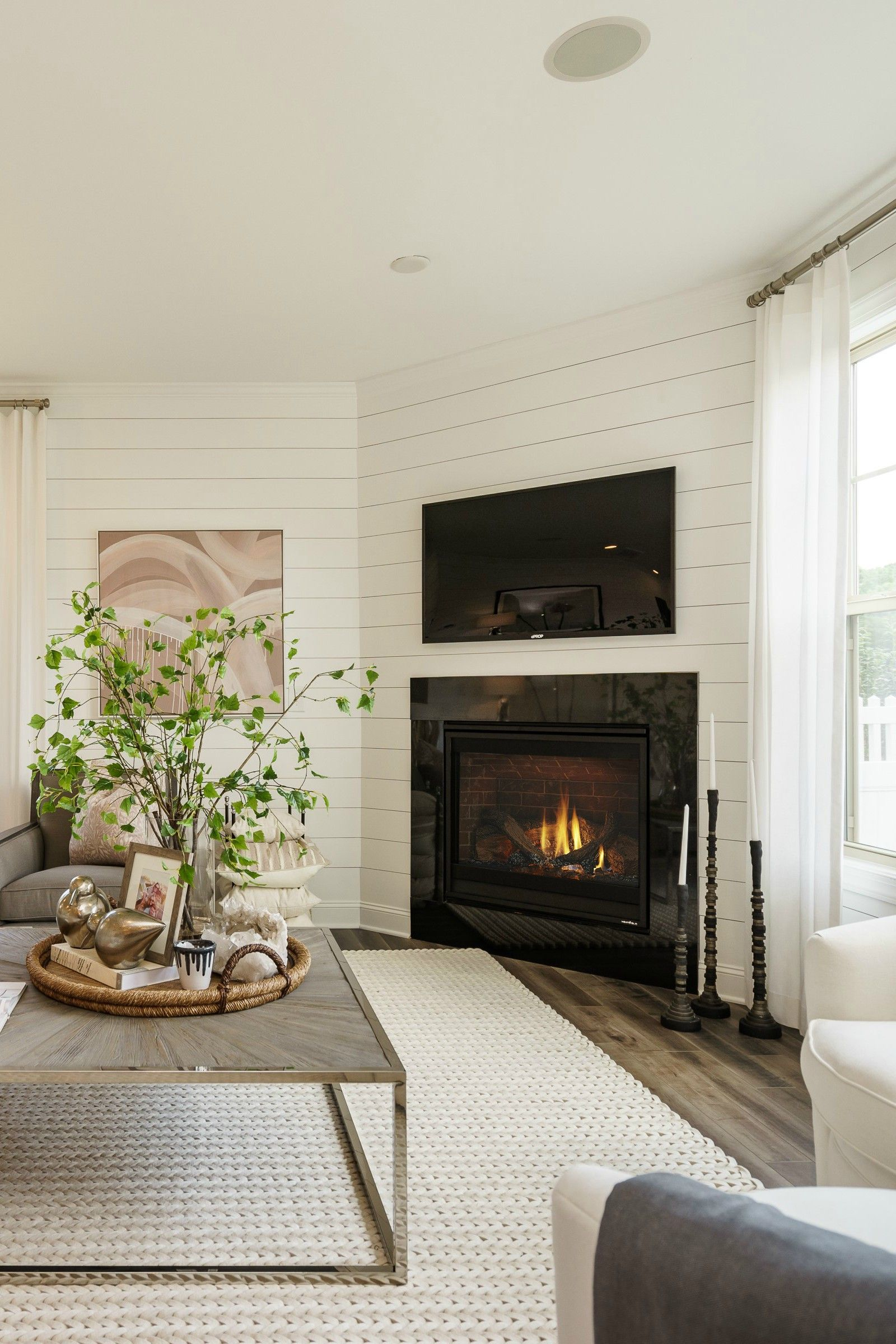Textural Elements Combined With Crisp Shiplap Lend Powerful Yet Subtle Dimension To This C Corner Fireplace Living Room Corner Gas Fireplace Fireplace Seating