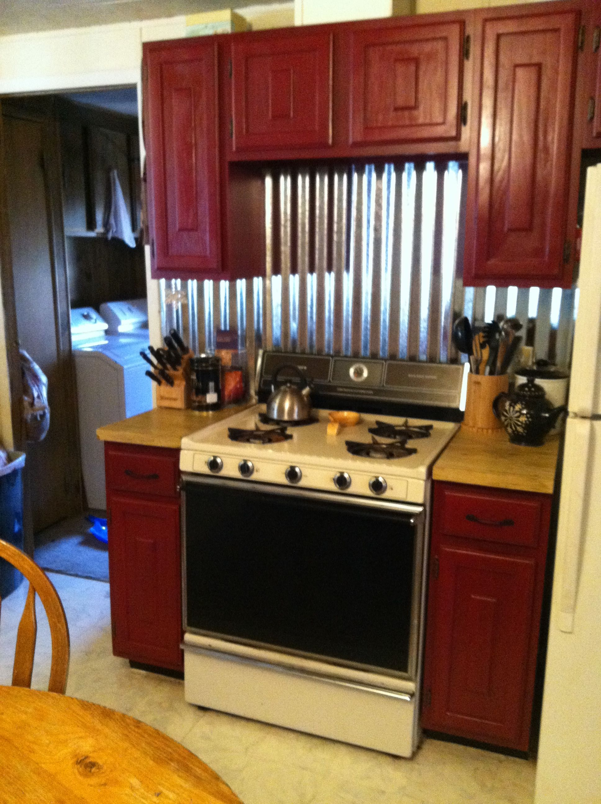 - Red Cabinets With A Tin Backsplash Rustic Kitchen Cabinets