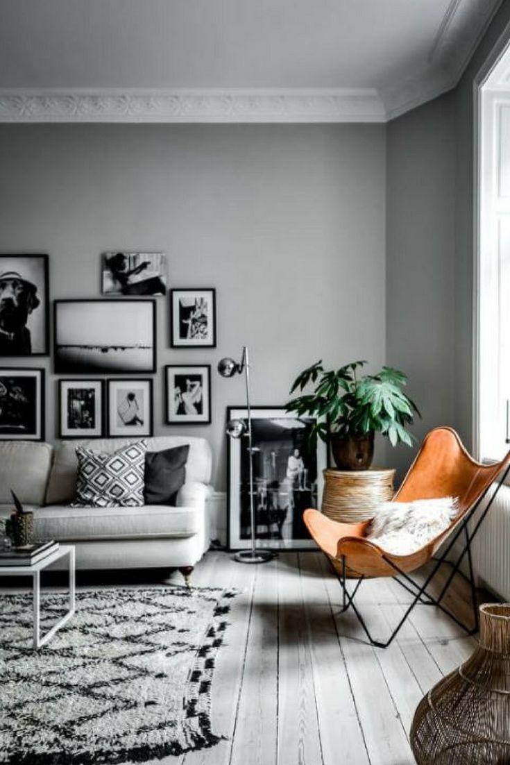 Scandi living décor styling | Floor rug inspo | Tan leather décor accents | Photo by Henrik Nero via Home Adore