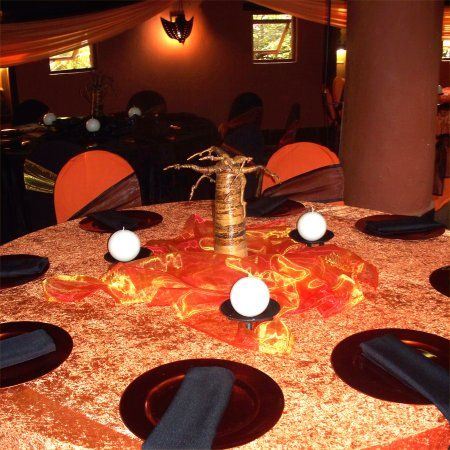 African themed wedding decor orange and brown troue for African party decoration ideas